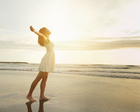 Smile Freedom and happiness woman on beach. She is enjoying serene ocean nature during travel holidays vacation outdoors. asian beauty photo