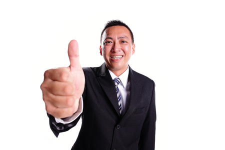 Smile businessman with thumb up isolated on white background, asian photo