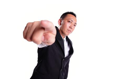 alzando la mano: Hombre de negocios serio señalando con el dedo sobre fondo blanco, asiático Foto de archivo
