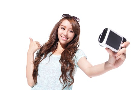 tourist: Happy travel young girl selfie taking pictures of herself isolated over white background, asian Stock Photo