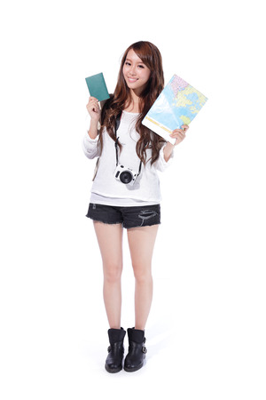 Happy woman tourist holding passport, camera and map on isolated white background