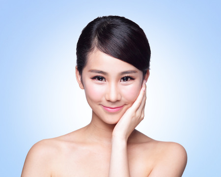 skin care face: Beautiful Skin care woman Face smile to you isolated on blue background. asian Beauty
