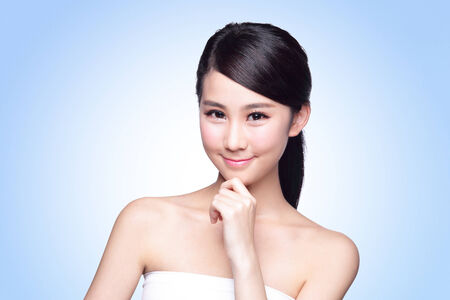 beautiful skin: Beautiful Skin care woman Face smile to you isolated on blue background. asian Beauty