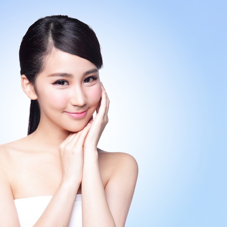 beauty make up: Beautiful Skin care woman Face smile to you isolated on blue background. asian Beauty