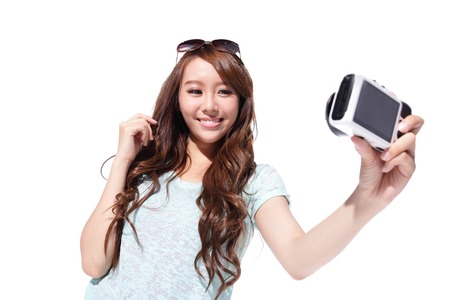 traveller: Happy travel young girl selfie taking pictures of herself isolated over white background, asian Stock Photo