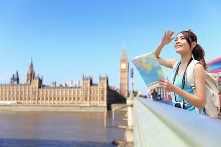 Happy travel woman look map in London with Big Ben tower,  London, UK,  asian beauty photo