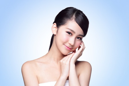 beauty skin: Beautiful Skin care woman Face smile to you isolated on blue background. asian Beauty