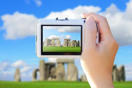 screen shot: camera taking photo with Stonehenge, Stonehenge an ancient prehistoric stone monument near Salisbury, Wiltshire, UK.