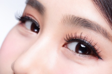 Beautiful woman eye with long eyelashes. asian model Imagens
