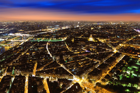 high view: Aerial Night view of Paris City and Seine river shot on the top of Eiffel Tower