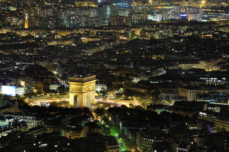 Arc de Triomphe: Aerial Night view of Arc de Triomphe and Paris City shot on the top of Eiffel Tower