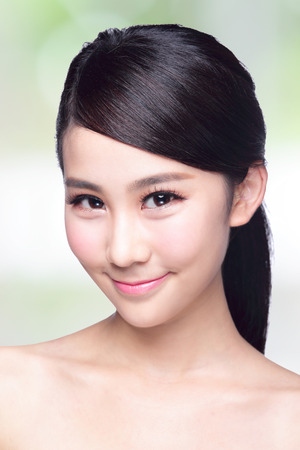 Beautiful Skin care woman Face smile to you with nature green background. asian Beauty photo