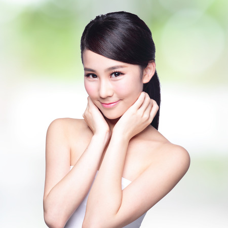 skin care woman: Beautiful Skin care woman Face smile to you with nature green background. asian Beauty