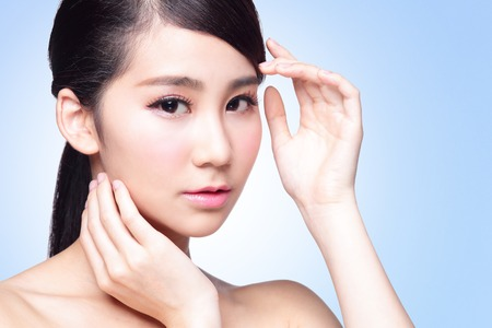 skin care woman: Beautiful Skin care woman isolated on blue background. asian Beauty
