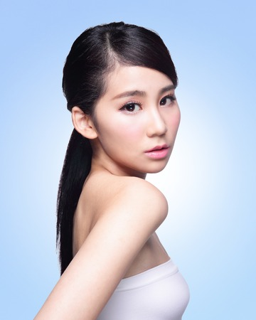 Beautiful Skin care woman Face isolated on blue background. asian Beauty photo
