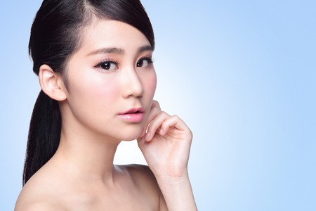 skin care woman: Beautiful Skin care woman Face isolated on blue background. asian Beauty Stock Photo
