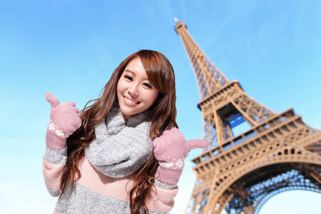 Happy travel woman with eiffel tower in Paris with blue sky photo