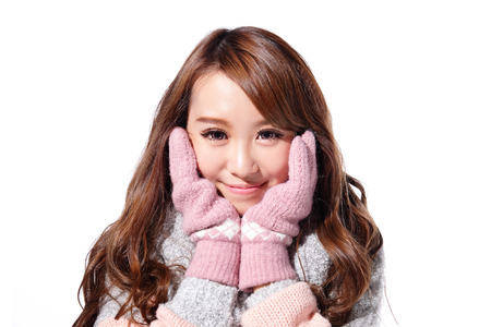 Young beautiful woman wearing winter clothing isolated on white background, asian beauty