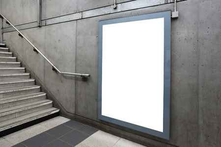 Blank billboard located in underground hall, London, United Kingdom, uk 版權商用圖片