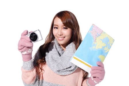 happy young travel woman wearing winter clothing and hold camera isolated on white background, asian beauty