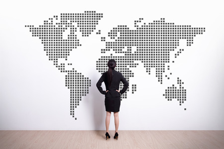 Back view of business woman look world map, asian photo