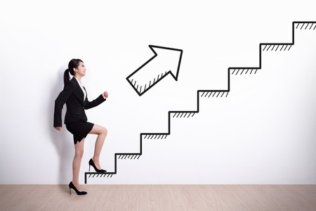 Business woman stepping up on stairs to gain her success with\ white wall background, asian