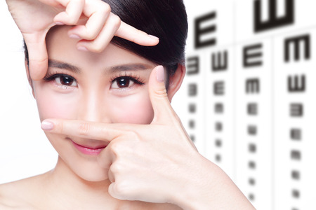 specialists: beautiful woman eye close up with the background of eye test chart, eye care concept, asian beauty