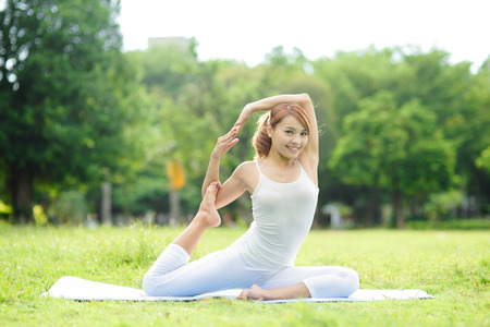 outdoor sports: Young sport girl do yoga in the park, asian beauty woman