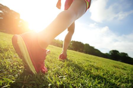 barefoot: Runner - running shoes closeup of woman barefoot running shoes. Female jogging in Park
