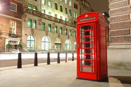 Red telephone box in London at night , uk, united kingdom