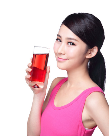Young happy woman drink juice ( red cranberry ) isolated on white background, asian Stock Photo