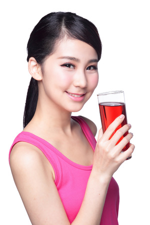chinese drinks: Young happy woman drink juice ( red cranberry ) isolated on white background, asian Stock Photo