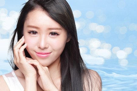 black beauty: Beauty Skin care concept, Beautiful woman face and long hair with Water splashes isolated on blue background, asian model