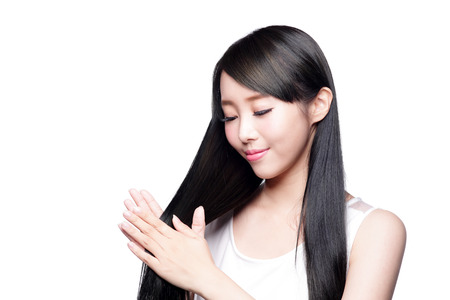 hair shampoo: Beautiful Woman touch her health long straight hair care with smile face, asian beauty model
