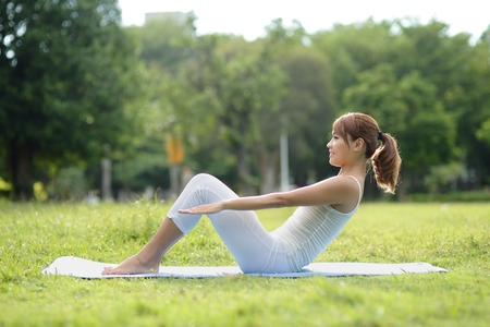 asian adults: Young sport girl do yoga in the park, asian beauty woman