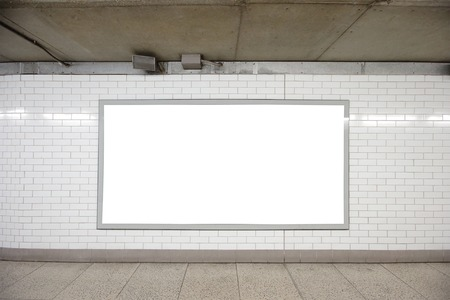 Blank billboard located in underground hall, London, United Kingdom, uk Фото со стока