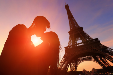 love silhouette: silhouette of romantic lovers with eiffel tower in Paris with sunset