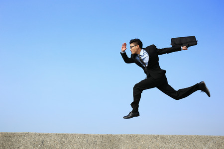 business time: business man running with blue sky background, full length, asian male