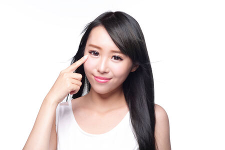 pointing finger up: Woman eye care - Beautiful Woman show her health eye with smile face isolated on white background, asian beauty Stock Photo
