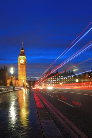 Big Ben and London at night with the lights of the cars passing by after rain, the most prominent symbols of both London and England