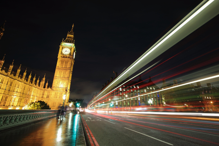 Big Ben and London at night with the lights of the cars passing by after rain, the most prominent symbols of both London and England photo