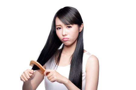 shoulder problem: hair problem - Unhappy young woman brush hair isolated on white background, asian