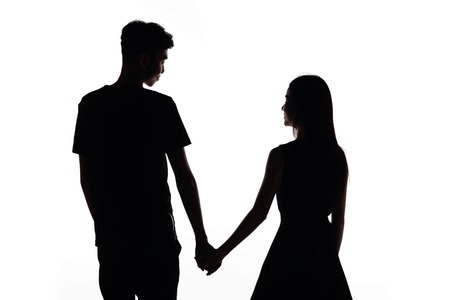 lover boy: silhouette of two lovers. Isolated on white background