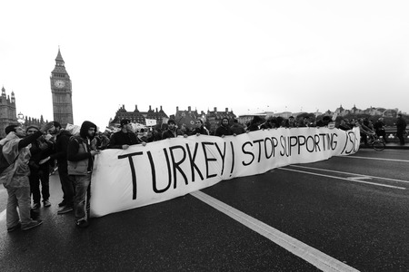LONDON, United Kingdom - OCTOBER 09, 2014: People appeal Turkey stop supporting ISIS in London with big ben, UK.