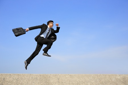 achievement: business man jump and run with blue sky background, full length, asian male