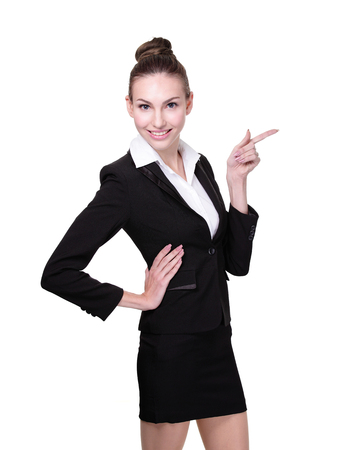 Portrait of happy young business woman show something isolated on white background, caucasian