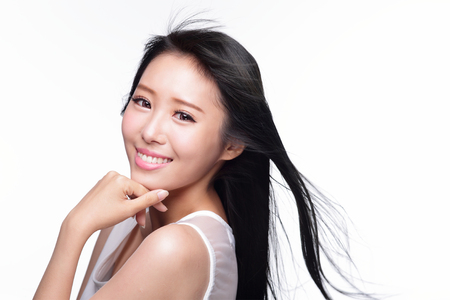 Beauty Skin care concept, Beautiful woman smile face with health teeth and hair isolated on white background, asian photo