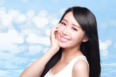 chinese women: Beauty Skin care concept, Beautiful woman face and long hair with Water splashes blue background, asian beauty