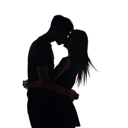 silhouette of two lovers. Isolated on white background photo