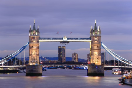 thames: Tower Bridge with reflections in the thames river at sunset in London, United Kingdom, England